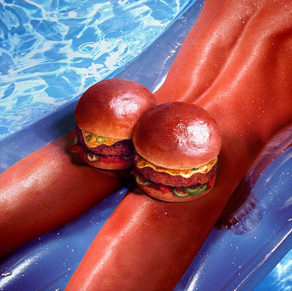 person with two burger on buttcheeks sunbathing